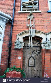 haunted house skeleton hanging above door entrance scary to scare