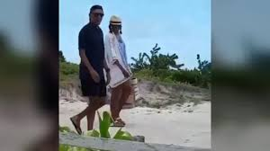 former president barack obama and michelle chillin on vacation