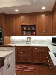 country kitchen backsplash ideas cherry cabinets carrara marble counters polished nickel