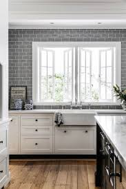 best images about floors walls pinterest herringbone grey subway tile against white cabinets and warm rustic wood floor