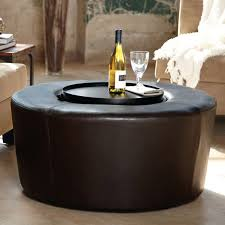 old and vintage dark brown round leather ottoman coffee table with