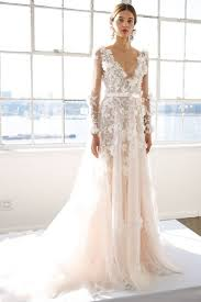 blush wedding dress picture of a blush wedding dress with a plunging neckline illusion