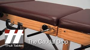 chiropractic drop table technique caudal drop positioning on tour portable table thuli tables