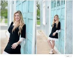 photographers in tx senior portrait session on turquoise door in georgetown tx