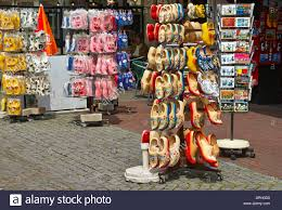 wooden dutch clogs on a stand for sale in a gift shop in