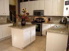 Backsplash Ideas For White Kitchens White Subway Tile With New Venetian Gold Granite Countertop