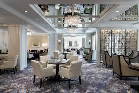club level the ritz carlton dallas large room with numerous seating and dining areas and elegant decor