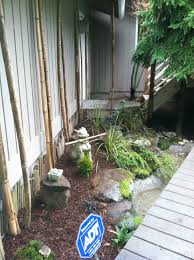 asian u2013themed alcove pond serves as a peaceful entry to home
