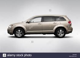 Dodge Journey Sxt - 2009 dodge journey sxt in beige drivers side profile stock photo