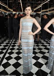 collins wows in barely there sheer silver gown at w magazine