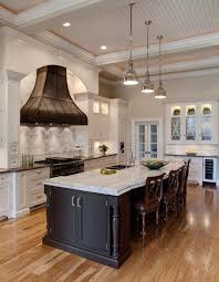 floors are color of our home which flows with white cabinets and floors are color of our home which flows with white cabinets and dark island