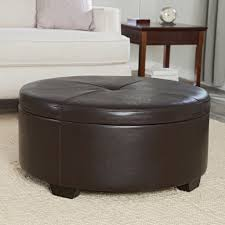 round dark leather ottoman coffee table with green glass wine and