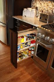spice rack pull outs with one enclosed side kitchen organization