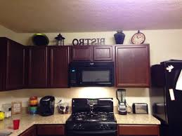 Decorating Above Kitchen Cabinets Pictures Colored Kitchen Cabinets Change Kitchen Cabinet Color Detrit Us