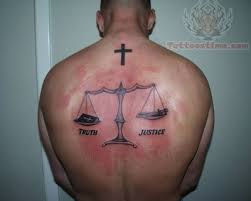 truth justice tattoo on back for men