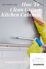 how to clean the kitchen cabinets clean greasy kitchen cabinets with ease wrapped in rust