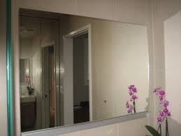 furniture wonderful frameless mirror by robern on beige tile wall