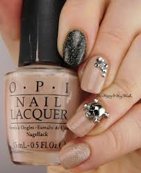neutral but sparkly skull nail art be happy and buy polish