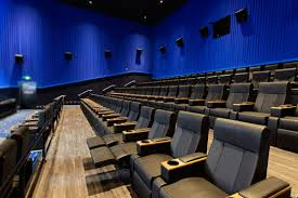 kick back and enjoy the movies in a king size luxury recliner at