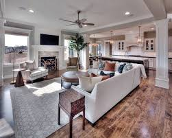 family room mounted tv with a standard fireplace open floor plan