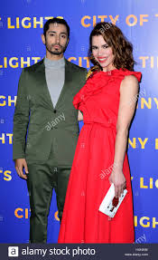 city of tiny lights riz ahmed and billie piper arriving for the city of tiny lights