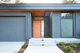 orange door and gray exterior give the home a classic eichler
