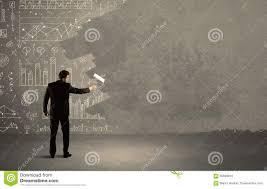 salesman painting over charts on wall stock photo image 65698912