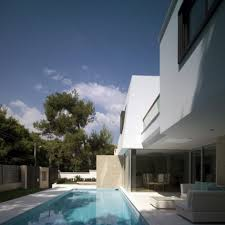astonishing modern pool design with grey sofa and fireplace outstanding modern pool design with white sofa