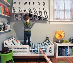 bedroom simple boys toddler room with floating storage and bookshelf