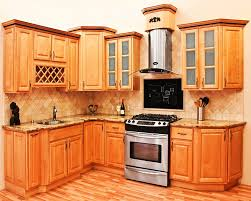 reddish brown cabinets maple vs cherry kitchen cabinets