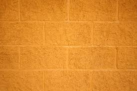 painted yellow cinder block wall texture picture free photograph