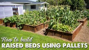 How To Build A Large Raised Garden Bed - how to build raised beds using pallets a thousand words youtube