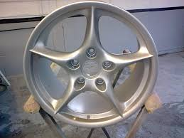 bentley blue powder coat wheel refurbishment and powder coating the body shop