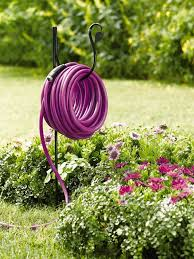18 creative ways to store your garden hose garden lovers club