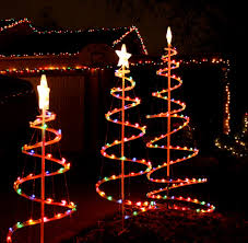 images of christmas tree lights and outdoor decorations lighted