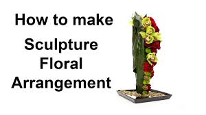 how to make a sculpture floral arrangement featuring decor pins