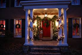 pillars in home decorating for christmas with magnolia and pine