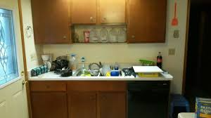 looking for someone to paint my kitchen cabinets painting kitchen cabinets or hire someone to do it