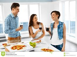 happy friends having dinner party home eating food friendship