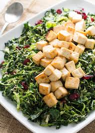 warm brussels sprout and kale salad with glazed tofu