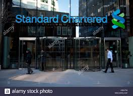 entrance to standard chartered bank in the city of london stock