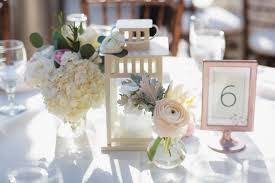 lantern wedding centerpieces lantern centerpiece with flowers including hydrangea ranunculus