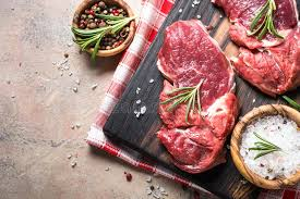 meat cutting table tops raw beef steak with herbs on stone table top view stock image