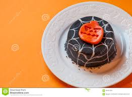 free halloween orange background pumpkin halloween cake in a white plate surface orange background stock