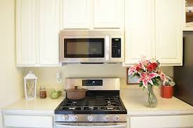 antique white finish kitchen cabinets white painted oak kitchen cabinets reveal momhomeguide