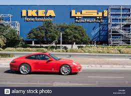 Ikea Dubai Porsche Racing Past An Ikea Shop With Its Sign In Arabic Festival