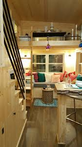 tiny house living area u shape couch with ladder to second loft