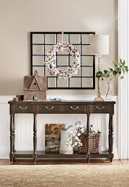 hang a wreath in front of an already existing wall mirror and you