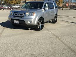 2010 honda pilot on 22x9 onyx 908 wheels tire size is 265 40 22