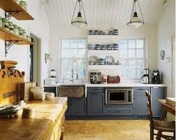 lovely dark blue lower cabinets with open shelving above two tone